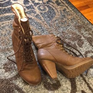 High heeled lace up boots
